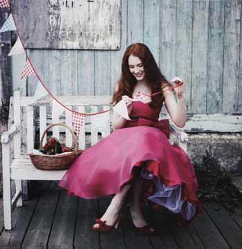 optmaidretroredweddingjpg A bridesmaid in a red organza dress by
