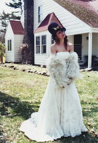 headpiece by Pickle Macaroni is paired with a short wedding dress