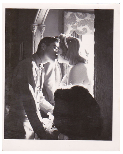 kissing-couple-in-window-opt