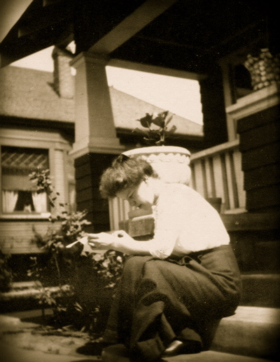 opt-1900-woman-reading-on-porch-steps