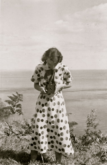 woman-with-dot-dress-and-camera-opt