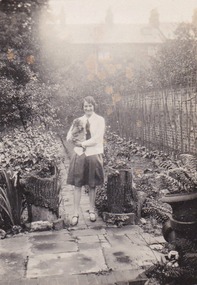 woman-with-cat-in-garden-opt